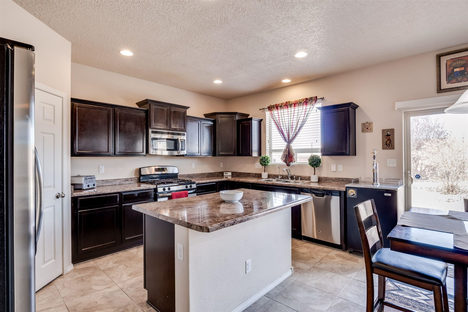 Photo of 1440 DESERT PAINTBRUSH Loop NE, Rio Rancho, NM 87144 (MLS # 989320)