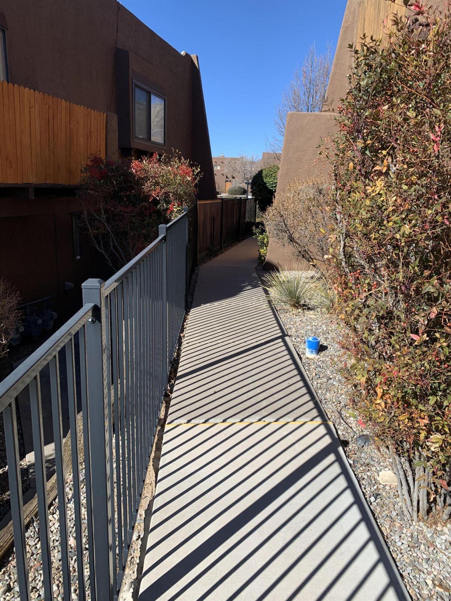 Photo of 5801 LOWELL Street NE #2C, Albuquerque, NM 87111 (MLS # 986328)