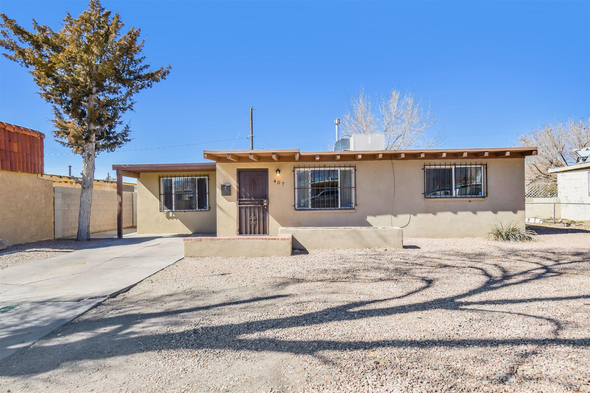 Photo of 407 CHARLESTON Street NE, Albuquerque, NM 87108 (MLS # 986458)