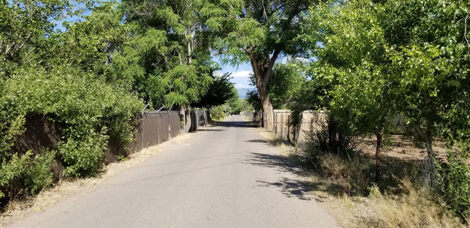 Photo of 9710 Rio Grande Boulevard NW, Albuquerque, NM 87114 (MLS # 979474)