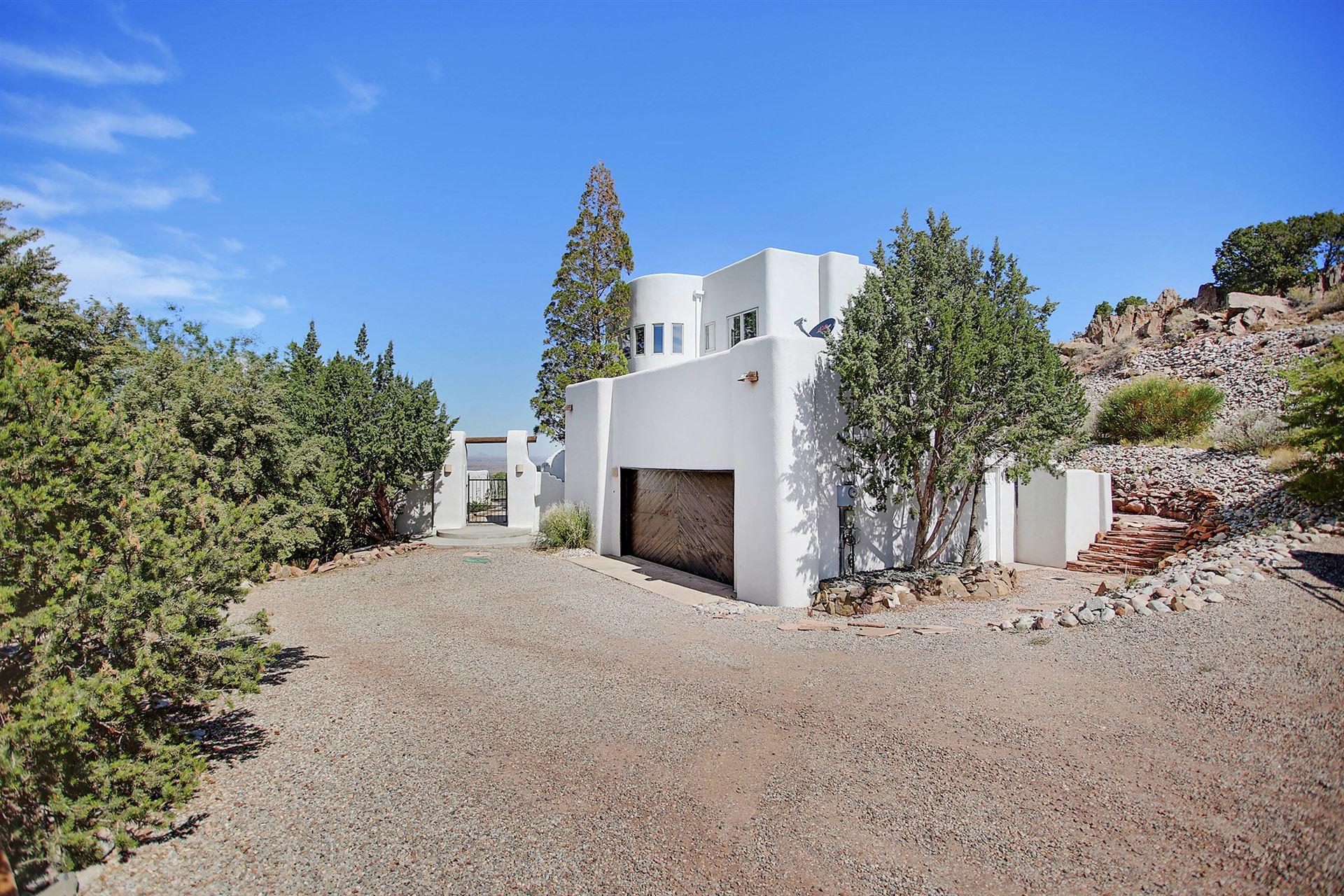 Photo of 9 Sombra Del Monte Road, Placitas, NM 87043 (MLS # 975487)