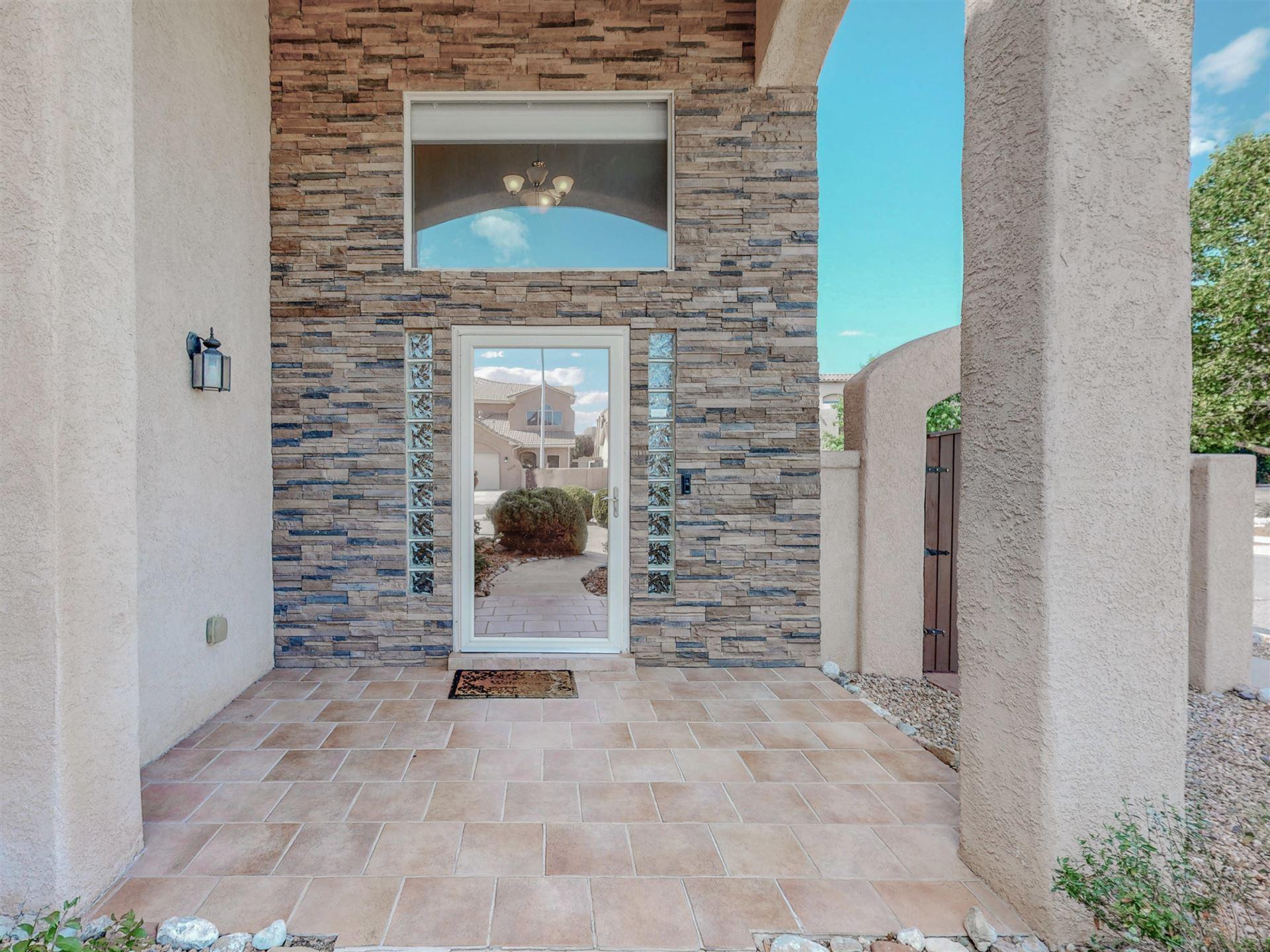 Photo of 9119 VILLAGE Avenue NE, Albuquerque, NM 87122 (MLS # 999501)