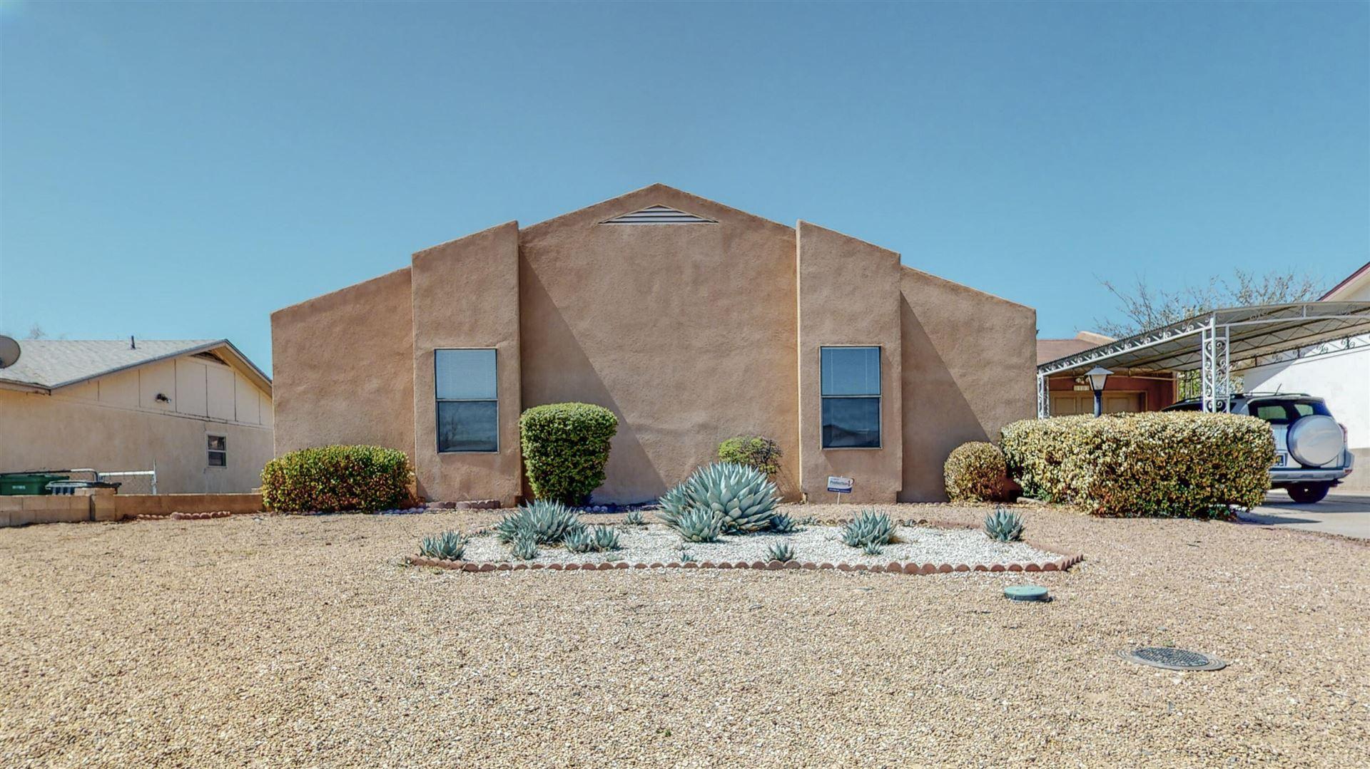 Photo of 313 WESTERN HILLS Drive SE, Rio Rancho, NM 87124 (MLS # 989535)