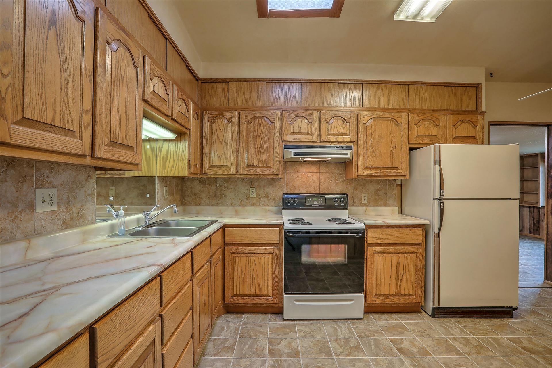 Photo of 11416 ANGELINA Place NE, Albuquerque, NM 87123 (MLS # 994574)