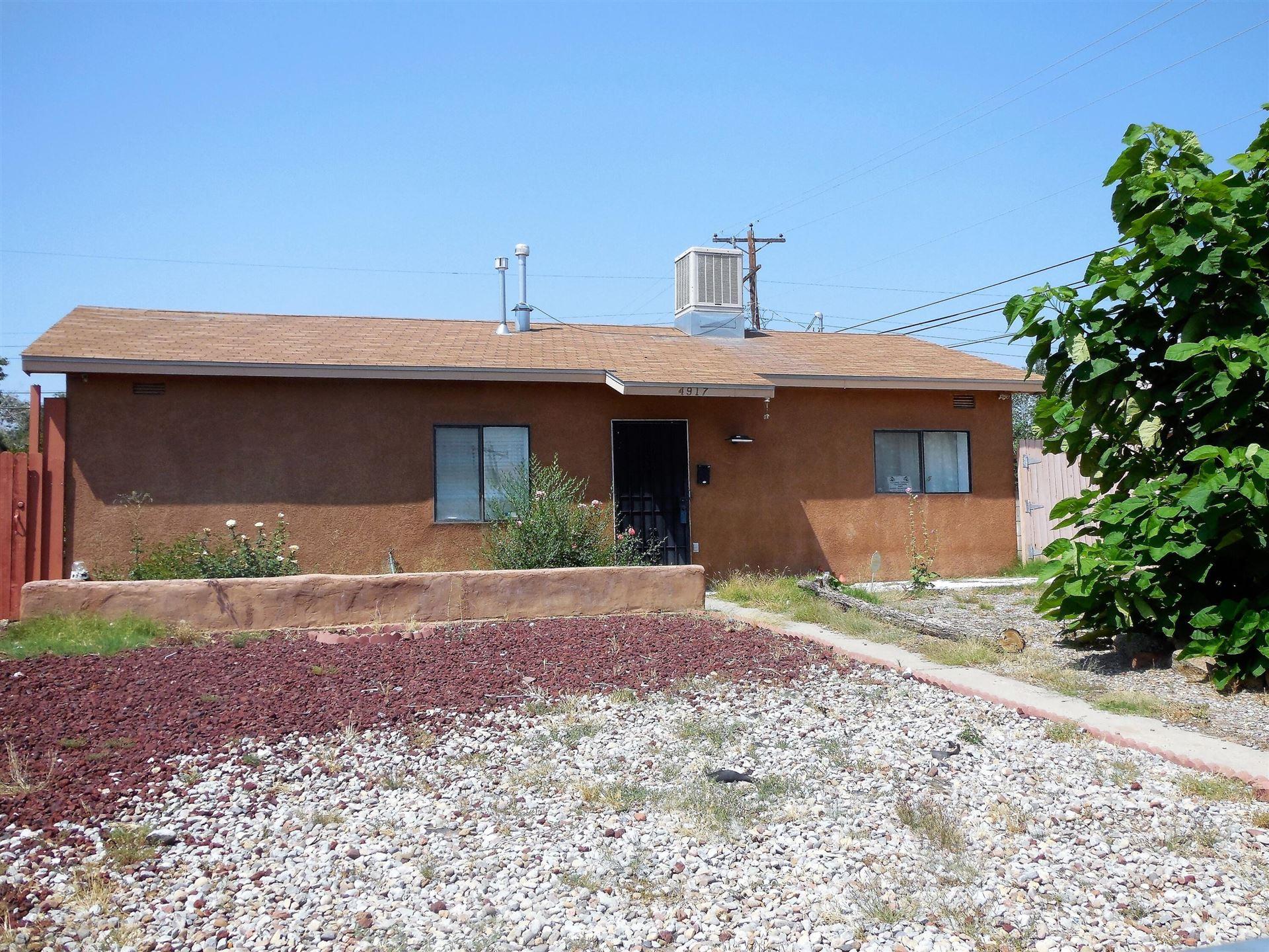 Photo of 4917 CHEROKEE Road NE, Albuquerque, NM 87110 (MLS # 1000583)