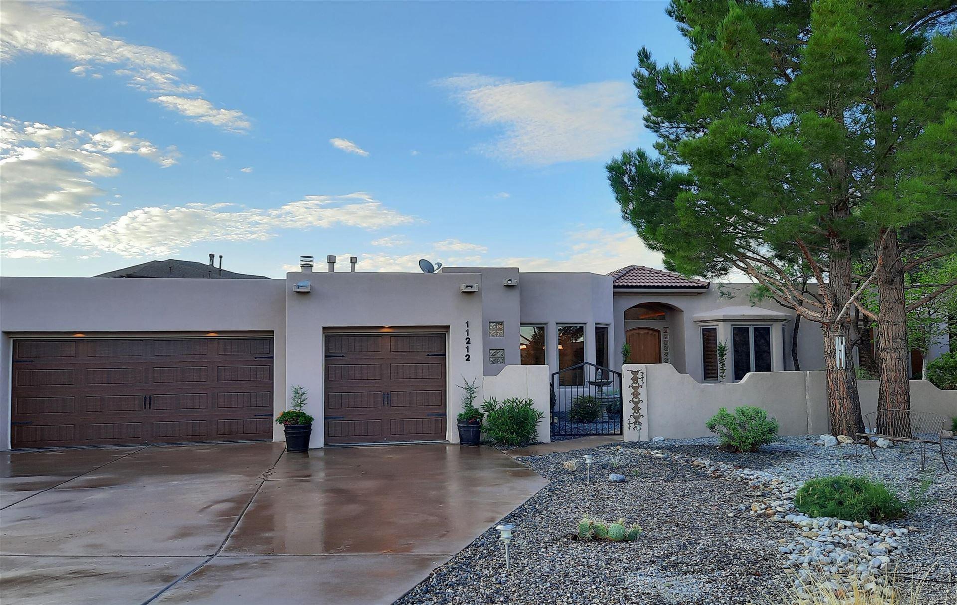 Photo of 11212 Wilshire Avenue NE, Albuquerque, NM 87122 (MLS # 997601)