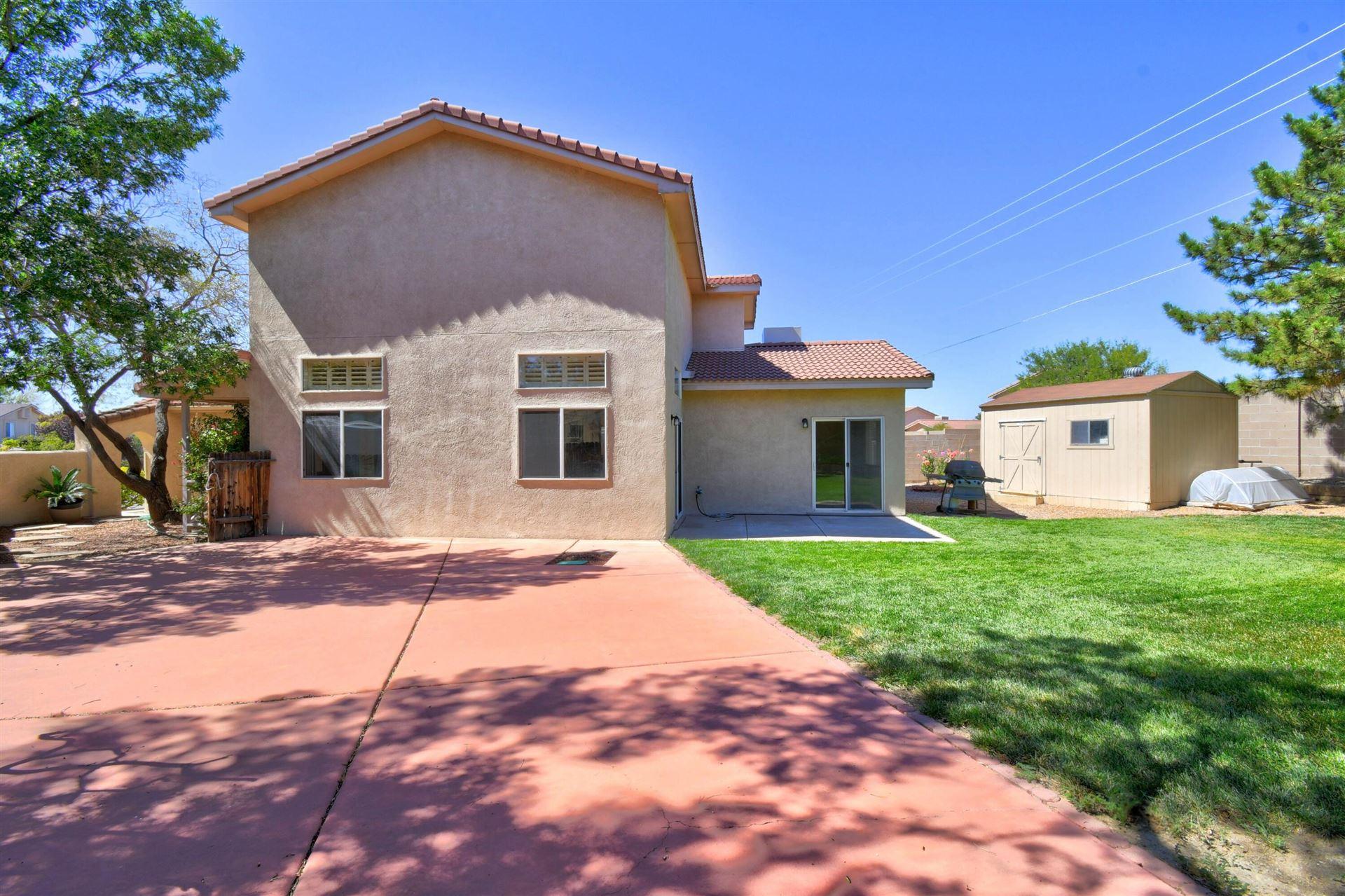 Photo of 8932 OLIVINE Street NE, Albuquerque, NM 87113 (MLS # 1001616)