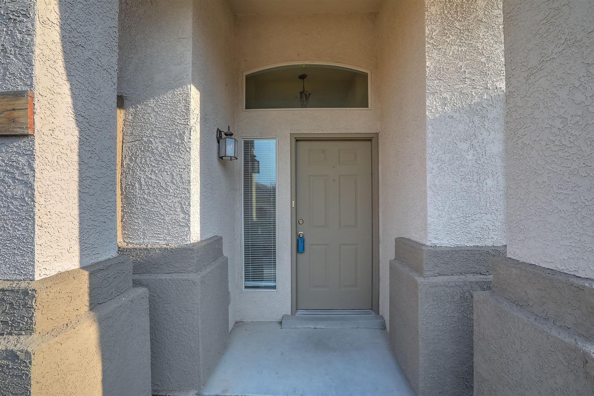Photo of 8108 CORN MOUNTAIN Place NW, Albuquerque, NM 87114 (MLS # 994641)