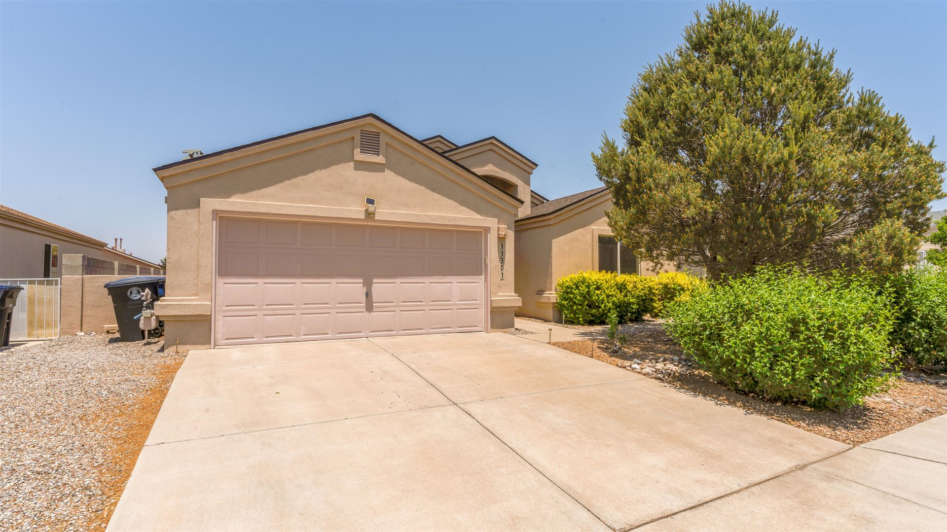 Photo of 11301 OCEOLA Road SE, Albuquerque, NM 87123 (MLS # 994689)