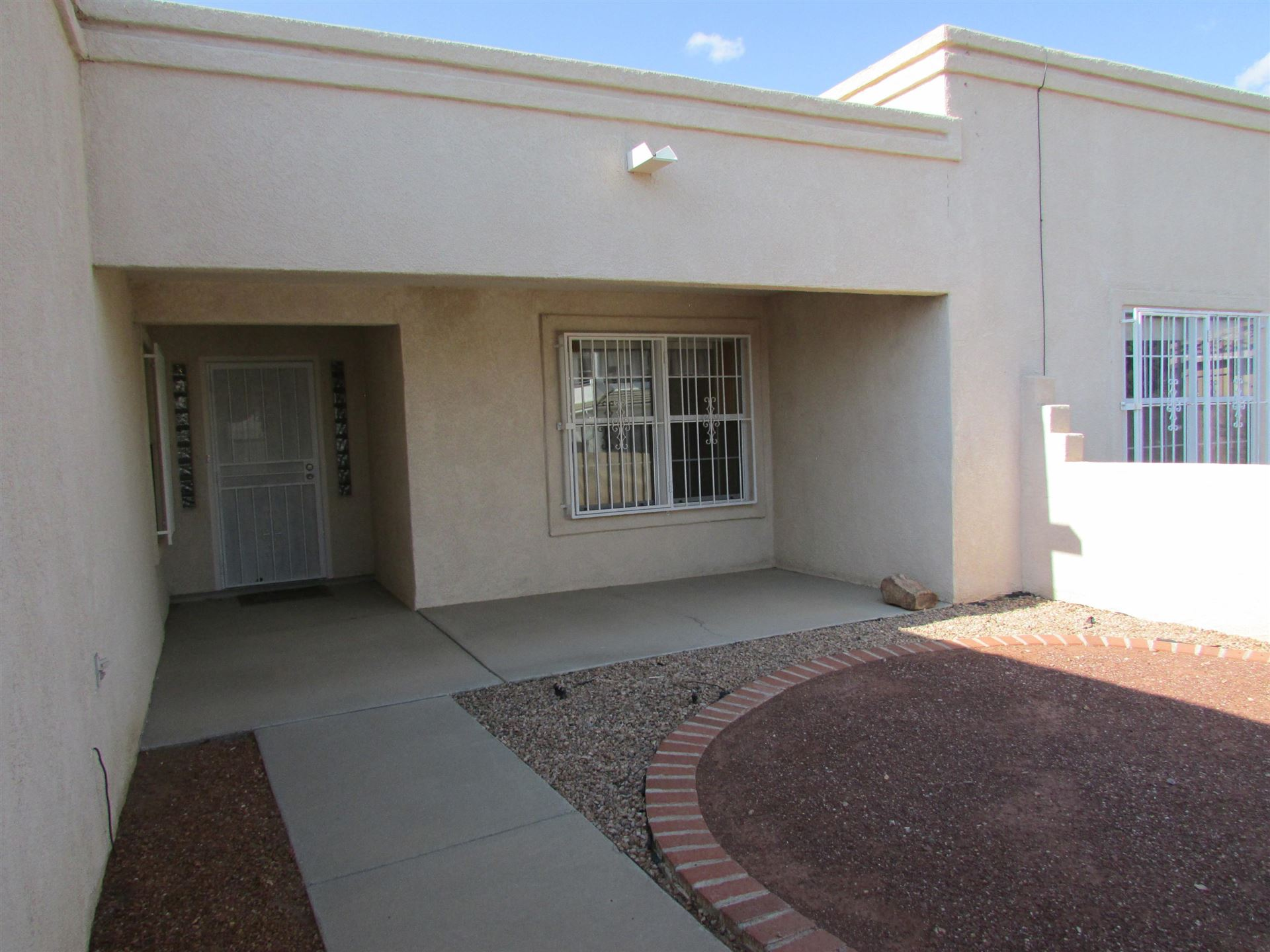 Photo of 8909 HELMICK Place NE, Albuquerque, NM 87122 (MLS # 994728)
