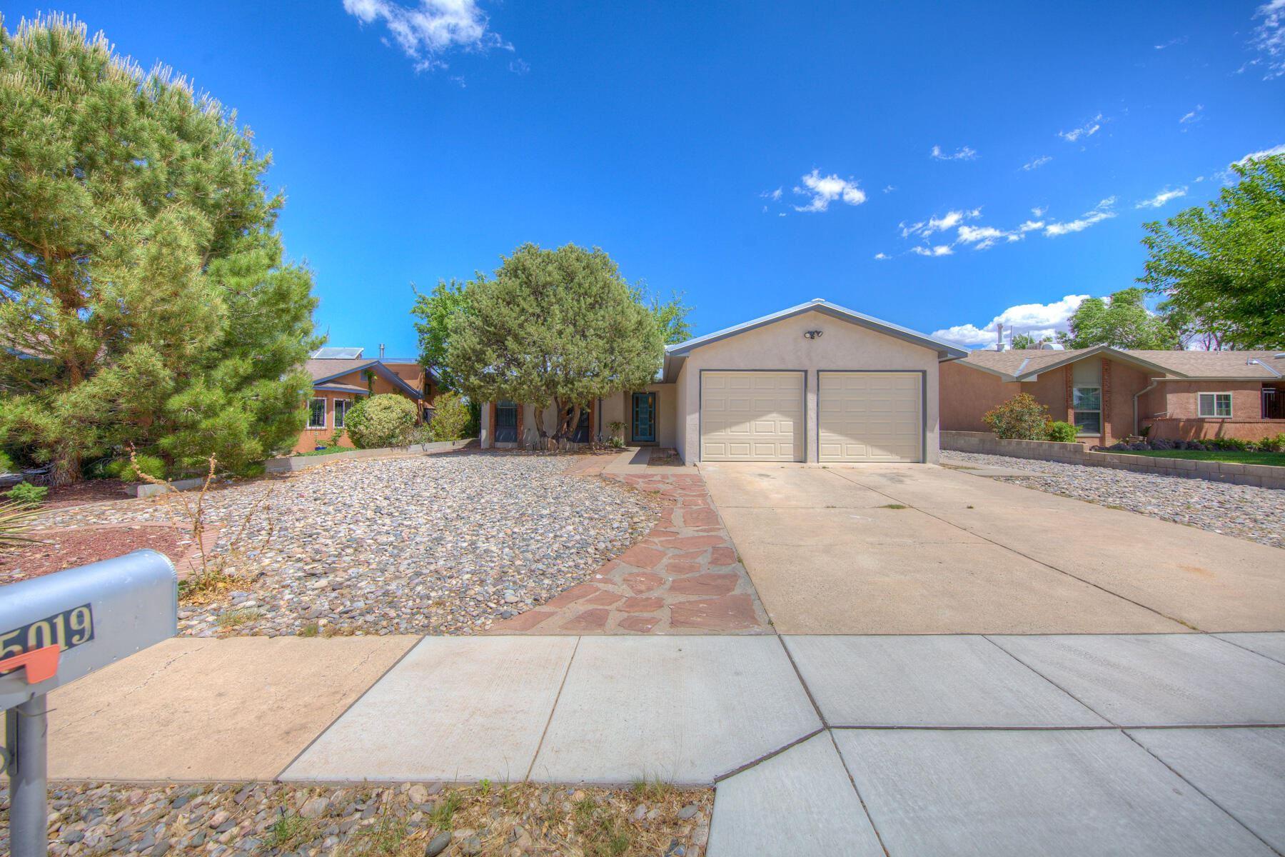 Photo of 5019 WATERCRESS Drive NE, Albuquerque, NM 87113 (MLS # 992736)