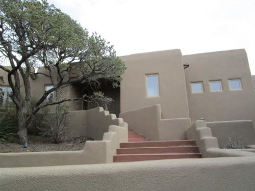 Photo of 69 EAGLE CREST Drive, Tijeras, NM 87059 (MLS # 985795)