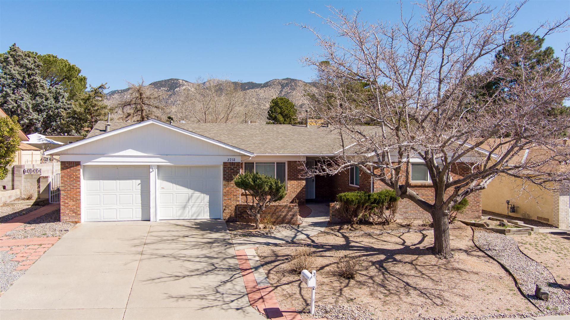 Photo of 3712 Madrid Drive NE, Albuquerque, NM 87111 (MLS # 989796)