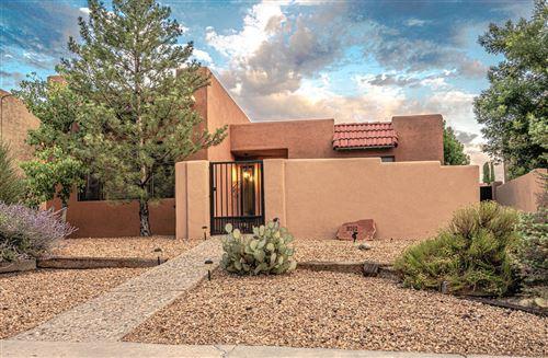 Photo of 8702 SPAIN Road NE, Albuquerque, NM 87111 (MLS # 971818)