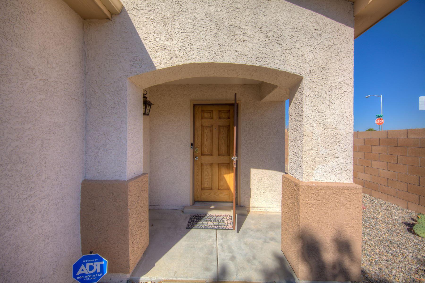 Photo of 73 EL CAMINO Loop NW, Rio Rancho, NM 87144 (MLS # 979851)