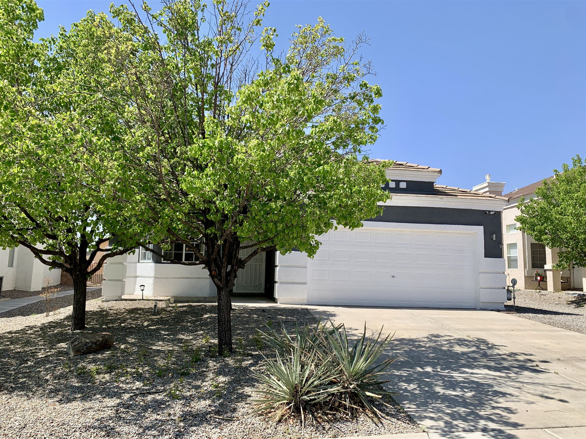 Photo of 7060 HUSKY Drive NE, Rio Rancho, NM 87144 (MLS # 989864)