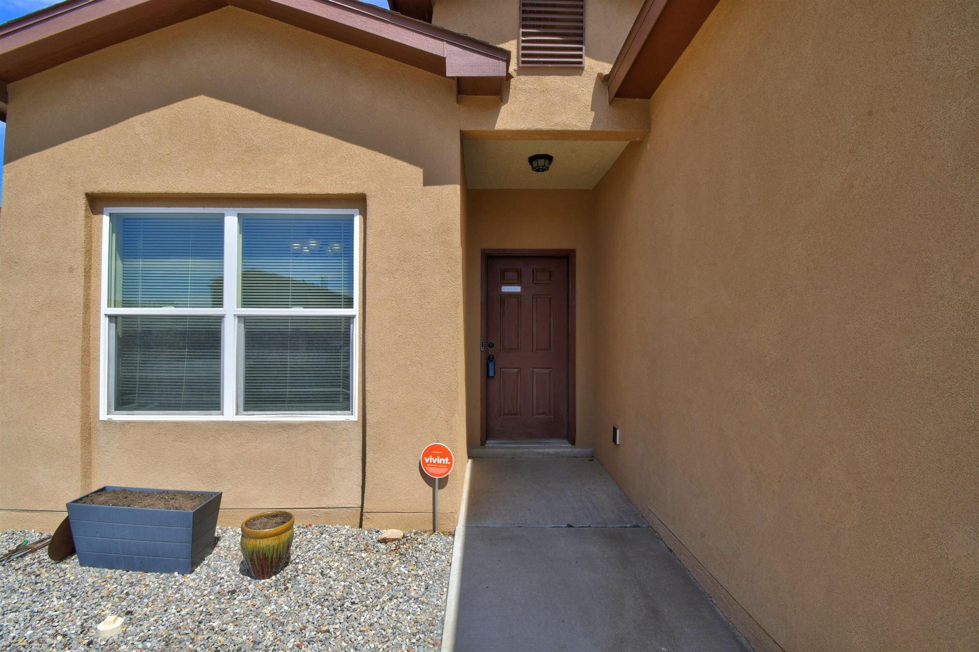 Photo of 6611 MOUNTAIN HAWK Loop NE, Rio Rancho, NM 87144 (MLS # 989874)