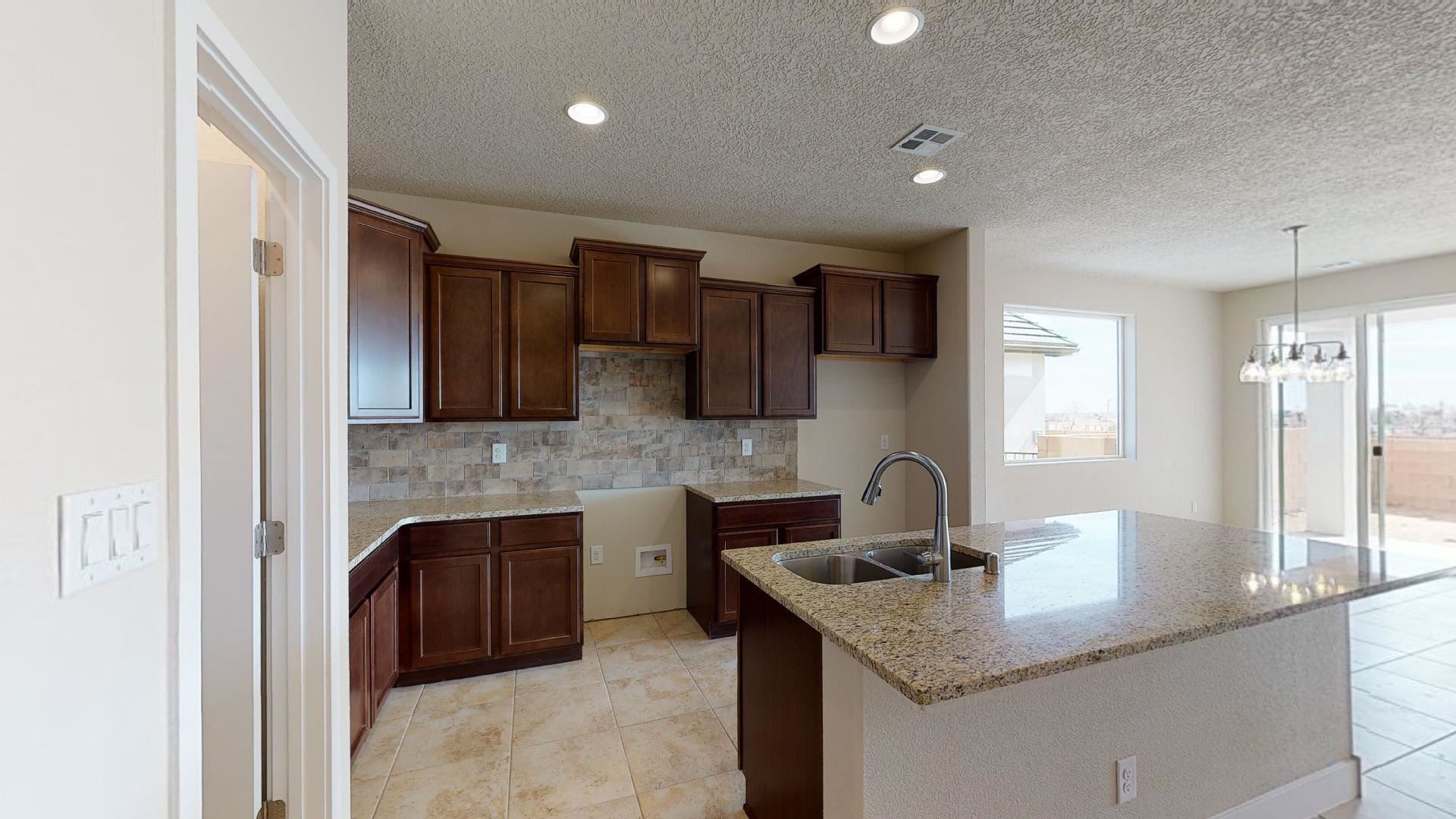 Photo of 6909 Pina Way NE, Rio Rancho, NM 87144 (MLS # 1000913)