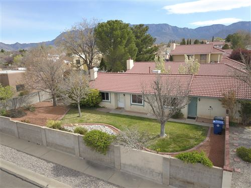 Photo of 10301 CASADOR DEL OSO NE, Albuquerque, NM 87111 (MLS # 965929)