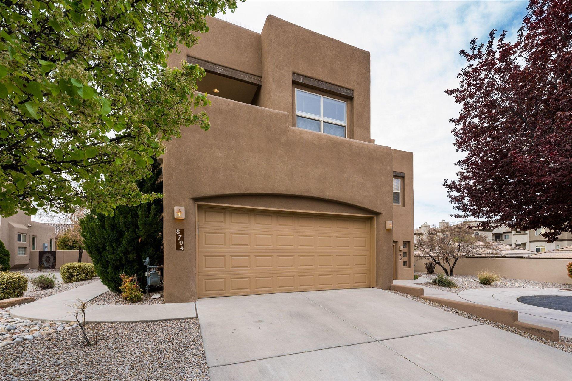 Photo of 8704 Desert Fox Way NE, Albuquerque, NM 87122 (MLS # 989935)