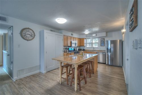 Photo of 4928 GOLDEN THREAD Drive NE, Albuquerque, NM 87113 (MLS # 977942)