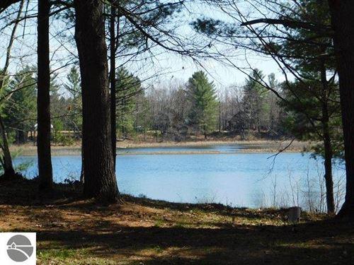 Photo of 6901 E Bass Lake Road, NE, Kalkaska, MI 49646 (MLS # 1886480)