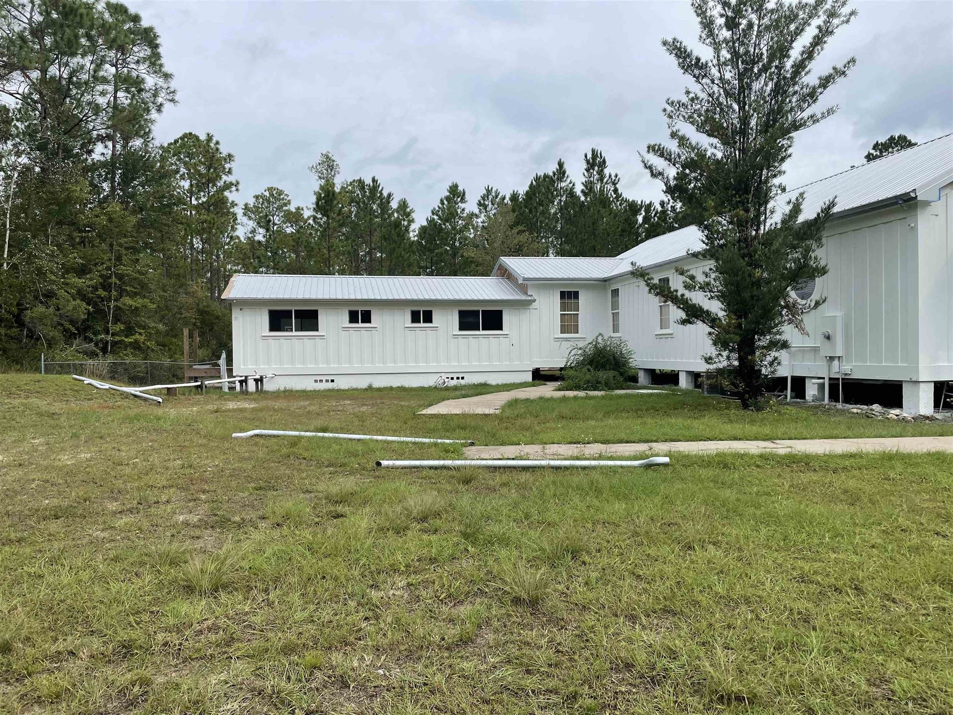 Photo of 2263 Curtis Mill Road, SOPCHOPPY, FL 32358 (MLS # 327138)