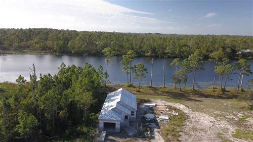 Photo of 230 Lake Mckissack Lane, CARRABELLE, FL 32322 (MLS # 328384)