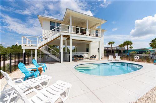 Photo of 565 W Gulf Beach Drive, ST GEORGE ISLAN, FL 32328 (MLS # 338523)