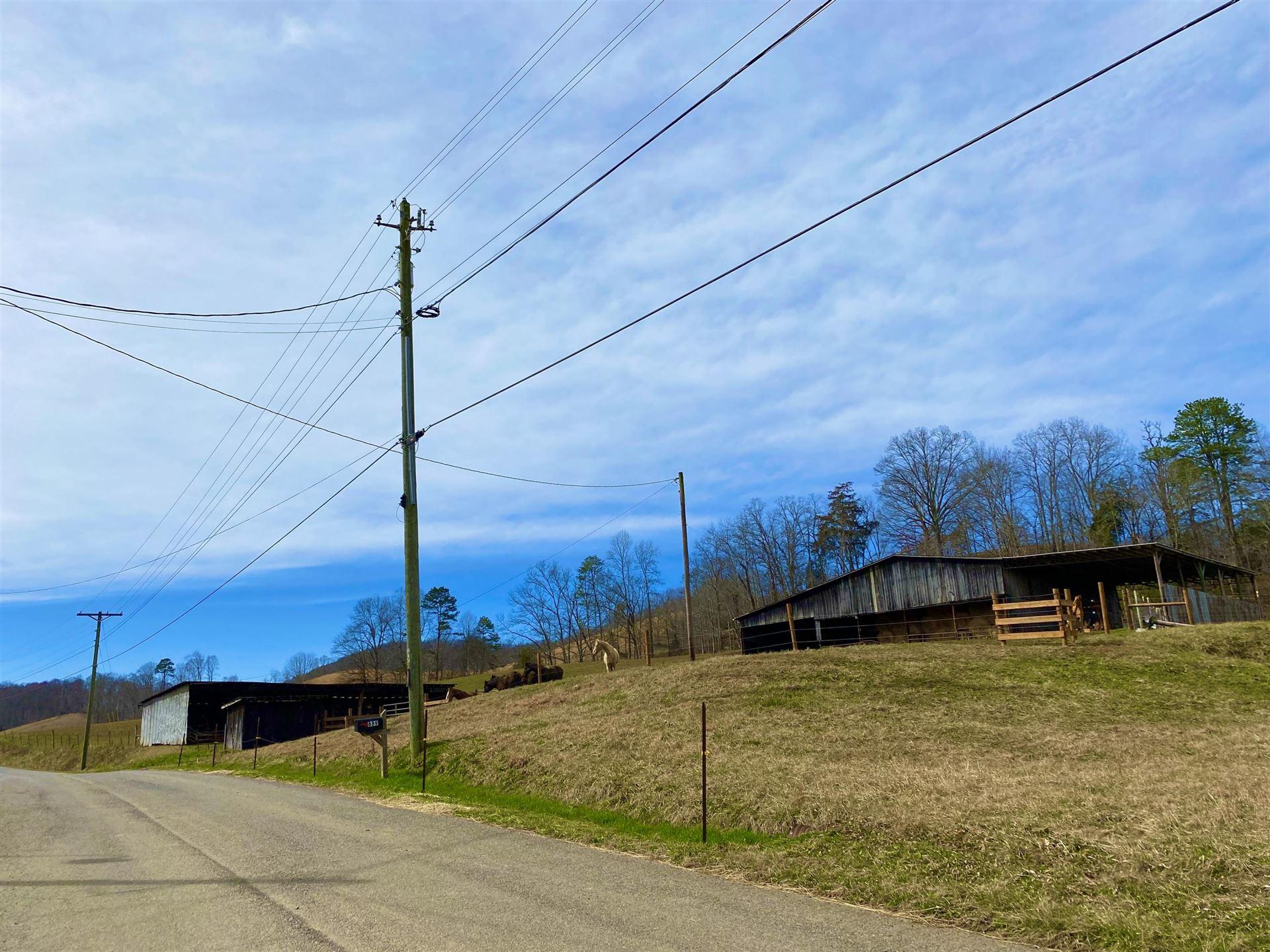 Photo of Tbd Caney Valley Loop, Surgoinsville, TN 37873 (MLS # 9919638)
