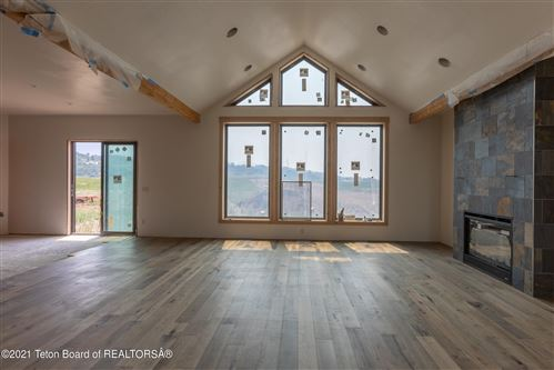 Photo of 159 RIVER TRAIL DR, Alpine, WY 83128 (MLS # 21-2639)