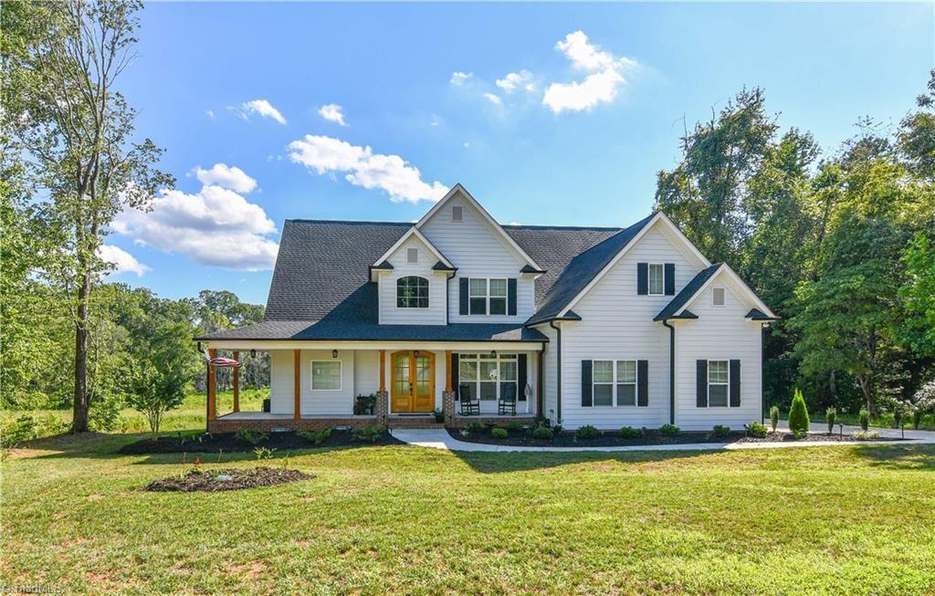 Photo of 7105 Rae Farms Way, Greensboro, NC 27455 (MLS # 988522)