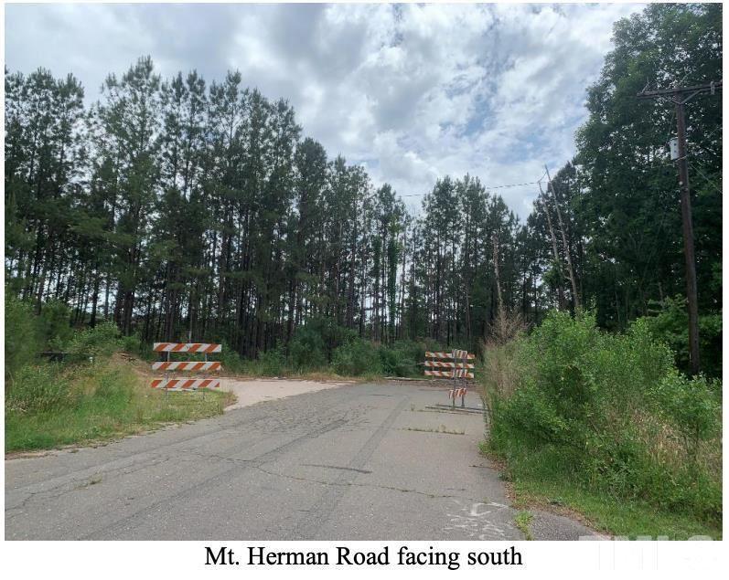 Photo of 6608 S Mt Herman Road, Raleigh, NC 27617 (MLS # 2399186)
