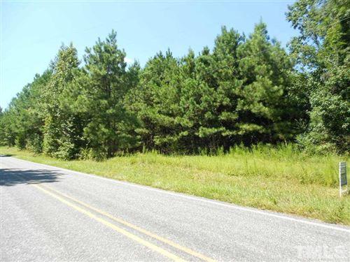 Photo of 556 Pete Thomas Road, Pittsboro, NC 27312 (MLS # 2341218)