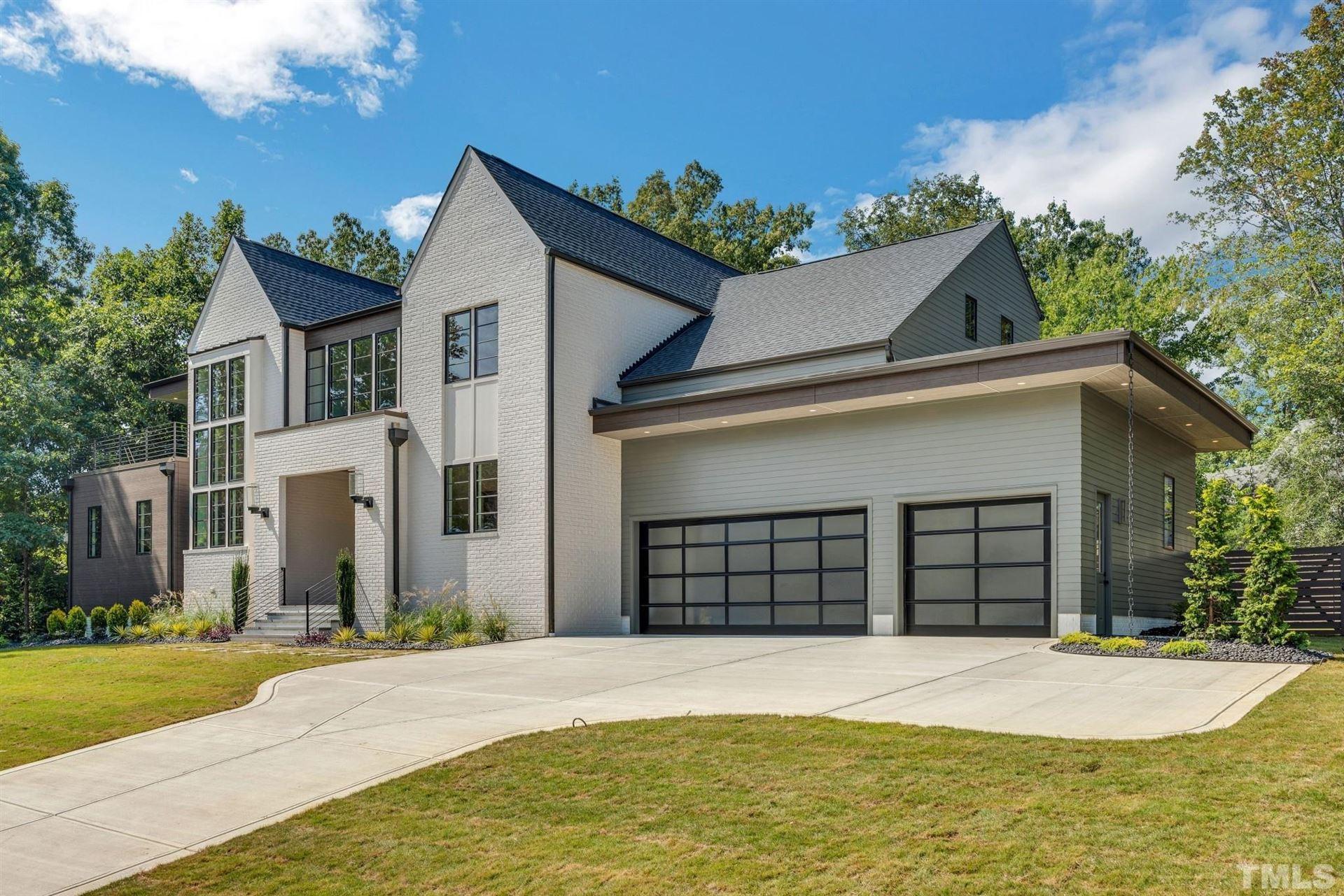 Photo of 1401 Hedgelawn Way, Raleigh, NC 27615 (MLS # 2392339)