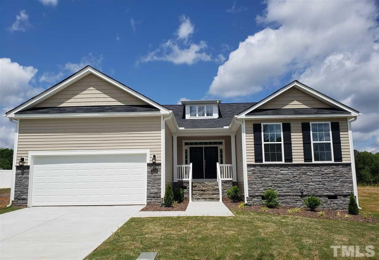 Photo of 2112 Water Front Drive, Willow Spring(s), NC 27529 (MLS # 2351379)