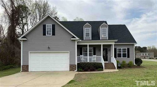 Photo of 2426 Rolling Tracks Road, Willow Spring(s), NC 27592 (MLS # 2308467)