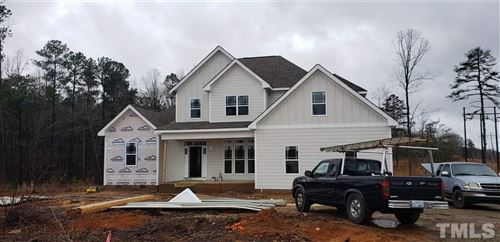 Photo of 765 Rollins Mill Road, Holly Springs, NC 27540 (MLS # 2281468)