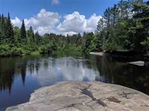 Photo of TBD OFF River, Humboldt, MI 49814 (MLS # 1116013)