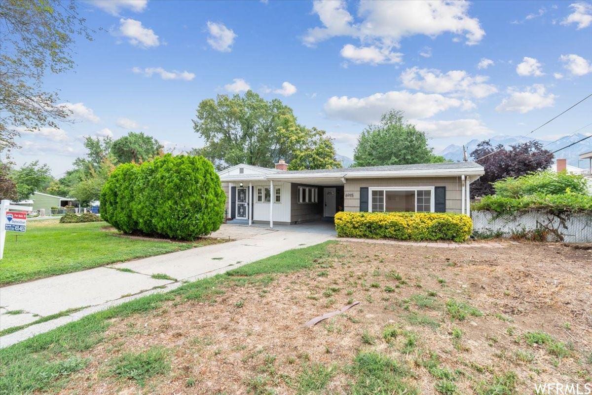 Photo of 6915 S BROOKHILL E DR, Cottonwood Heights, UT 84121 (MLS # 1753045)