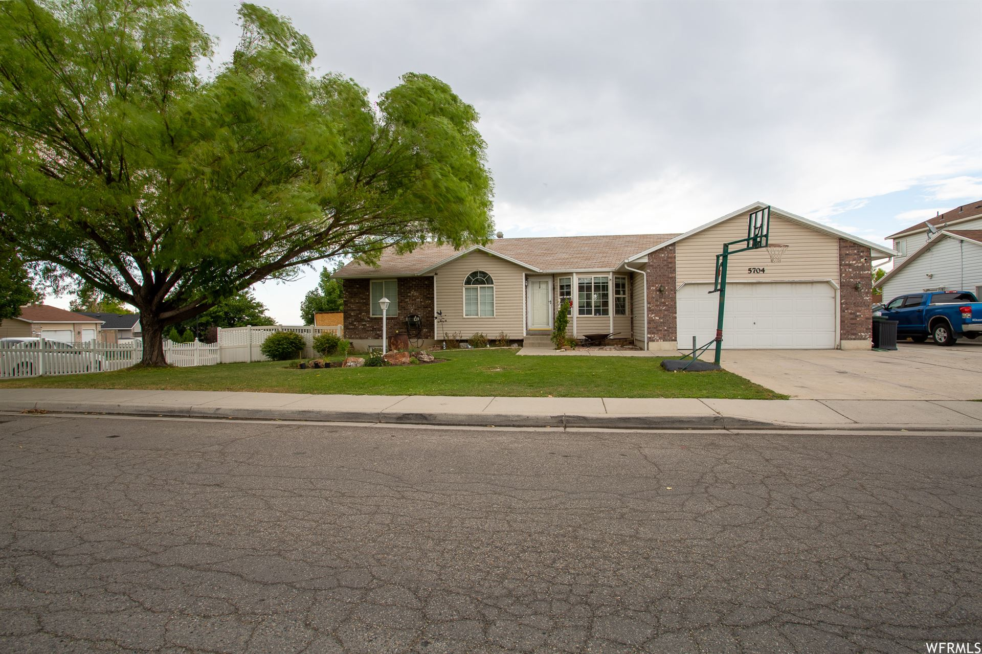 Photo of 5704 W HUNTER HOLLOW DR, West Valley City, UT 84128 (MLS # 1757101)