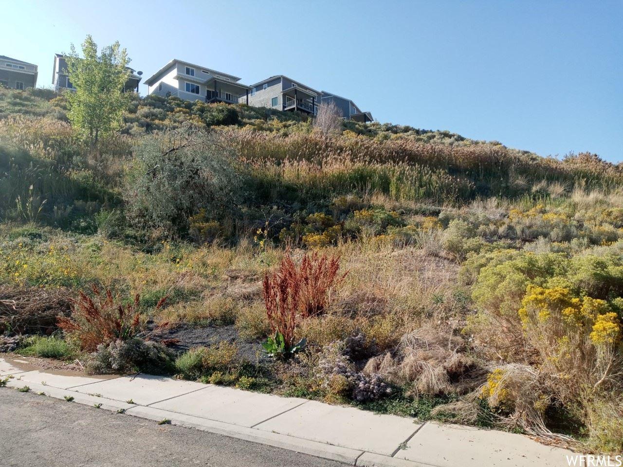 Photo of 132 E SUNSET VISTA CT, North Salt Lake, UT 84054 (MLS # 1771121)