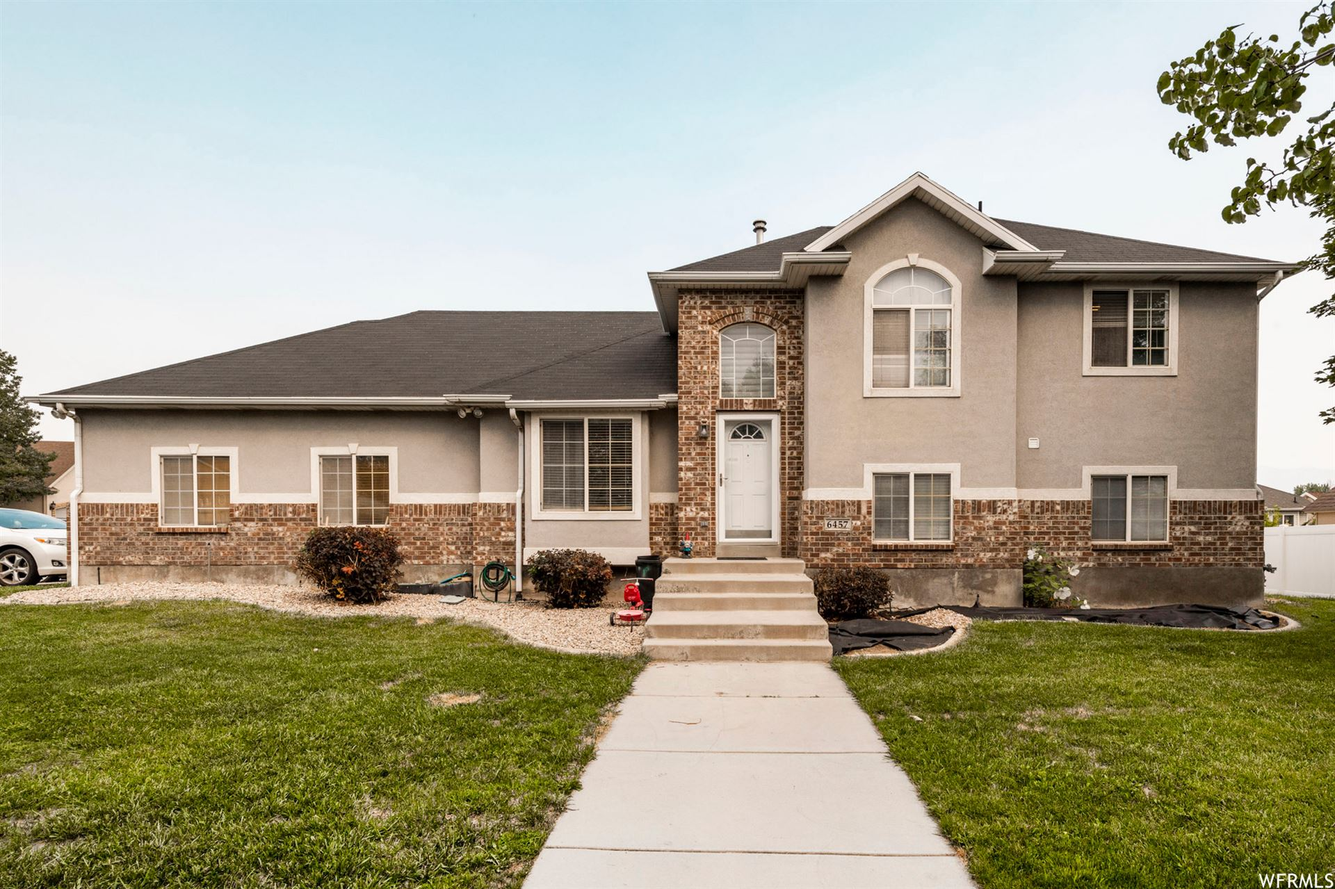 Photo of 6457 S GOLD MEDAL W DR, Taylorsville, UT 84129 (MLS # 1767126)