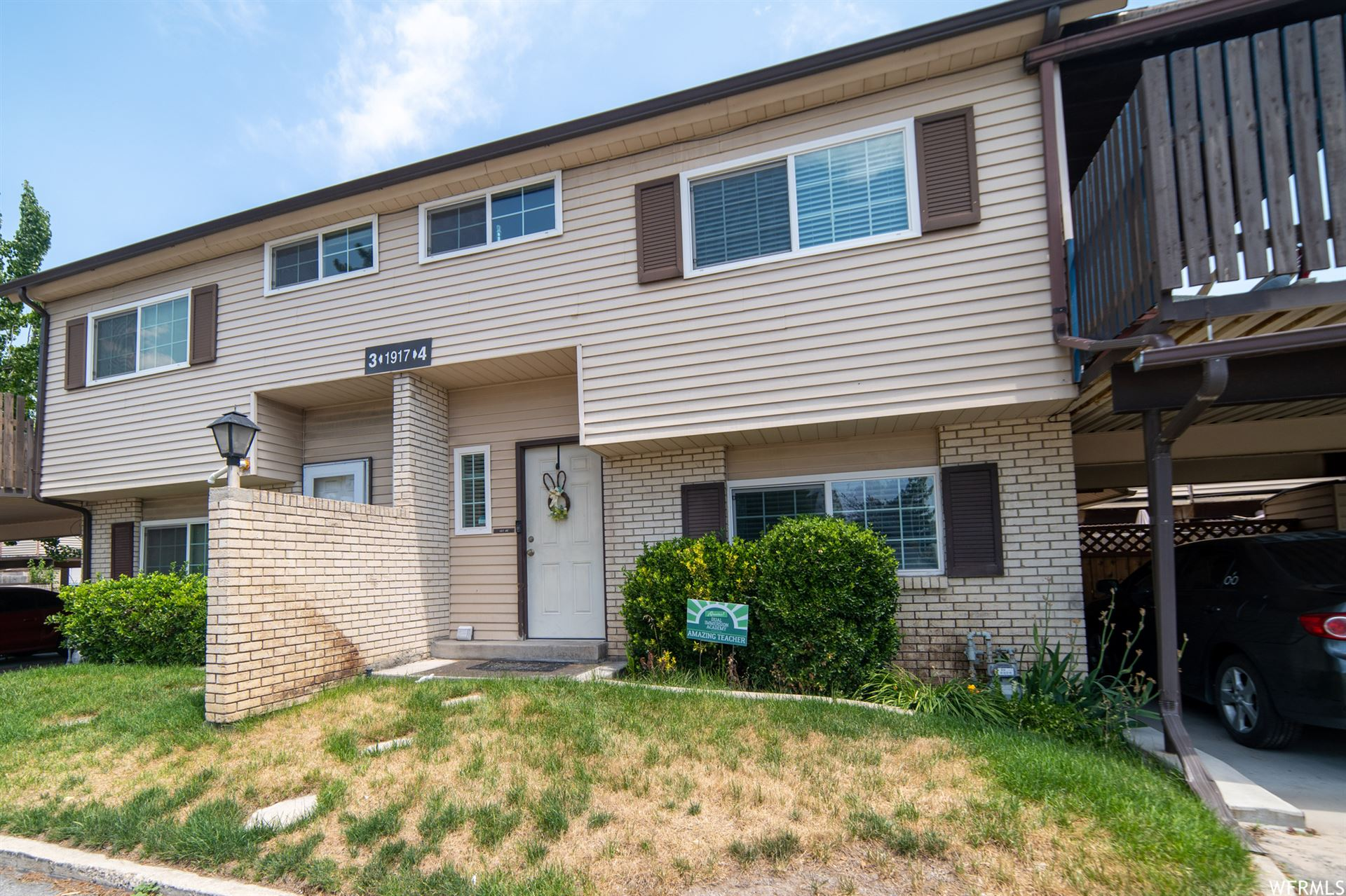 Photo of 1917 W HOMESTEAD FARMS LN #4, West Valley City, UT 84119 (MLS # 1749144)