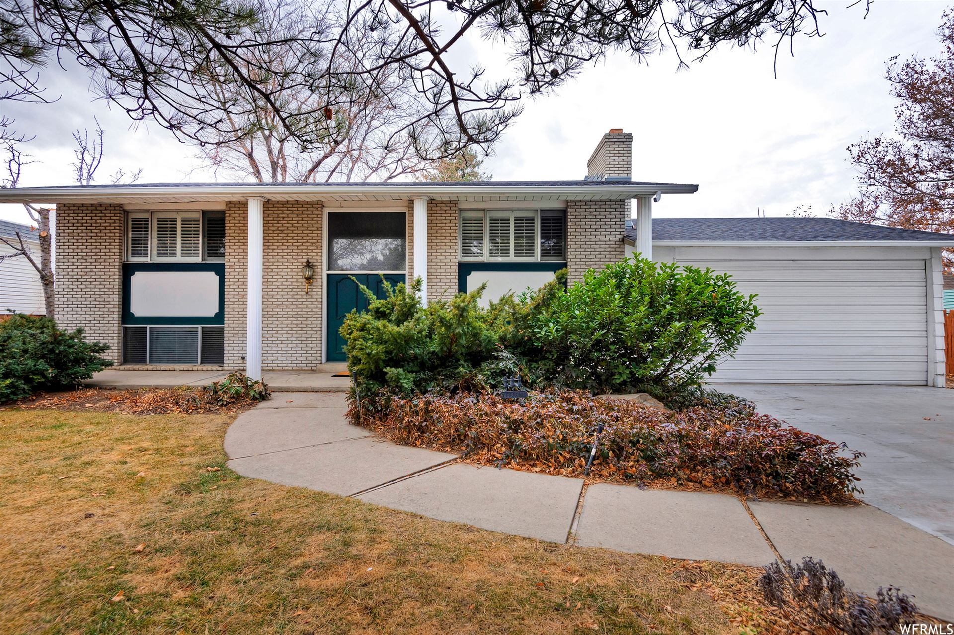 Photo of 5958 S GREENWOOD DR, Murray, UT 84123 (MLS # 1732158)