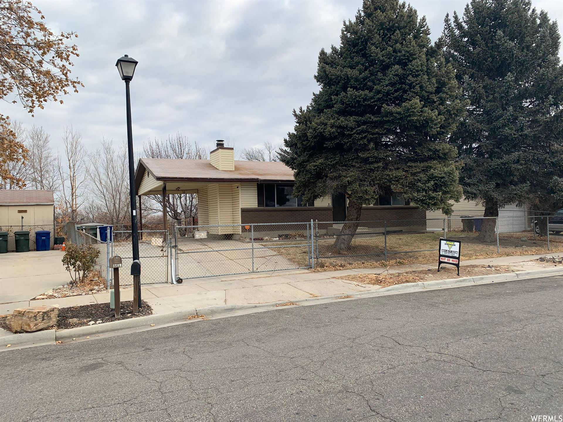 Photo of 5534 W PEGGY LN, West Valley City, UT 84120 (MLS # 1718176)