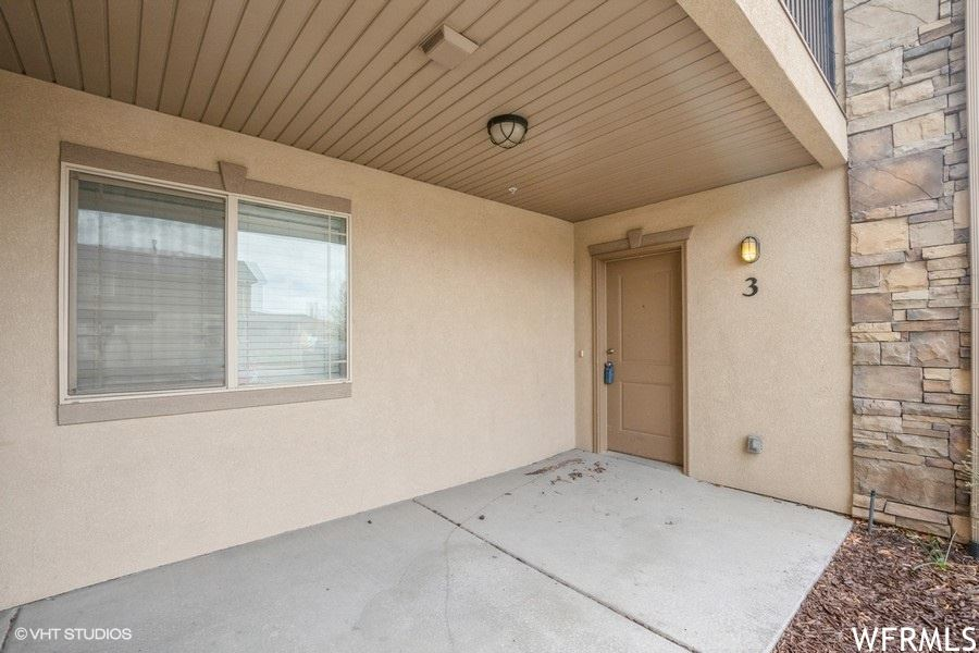 Photo of 6941 S VILLAGE RIVER LN #3, Midvale, UT 84047 (MLS # 1734176)