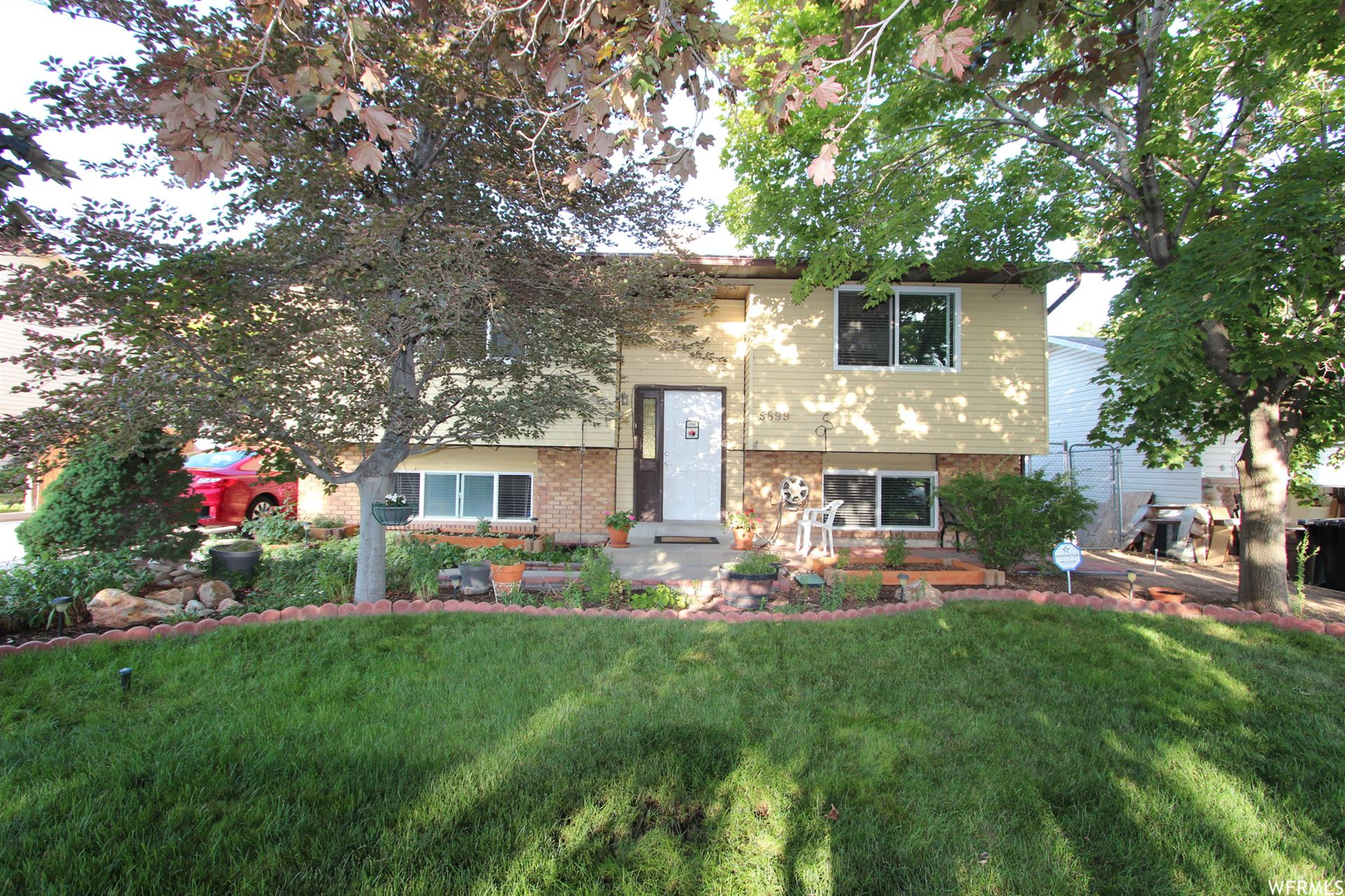 Photo of 5899 S COUNTRY HILLS DR #67, Taylorsville, UT 84123 (MLS # 1753176)