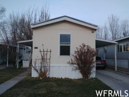 Photo of 4665 STORM W DR, Taylorsville, UT 84123 (MLS # 1732249)