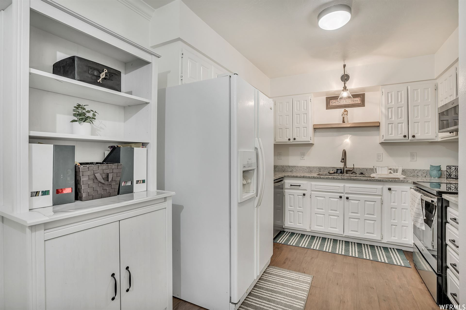 Photo of 3051 S ORCHARD DR #A/1, Bountiful, UT 84010 (MLS # 1768373)